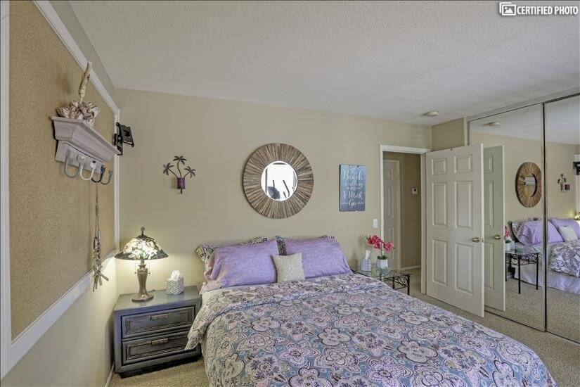 Third bedroom with mirrored closets.