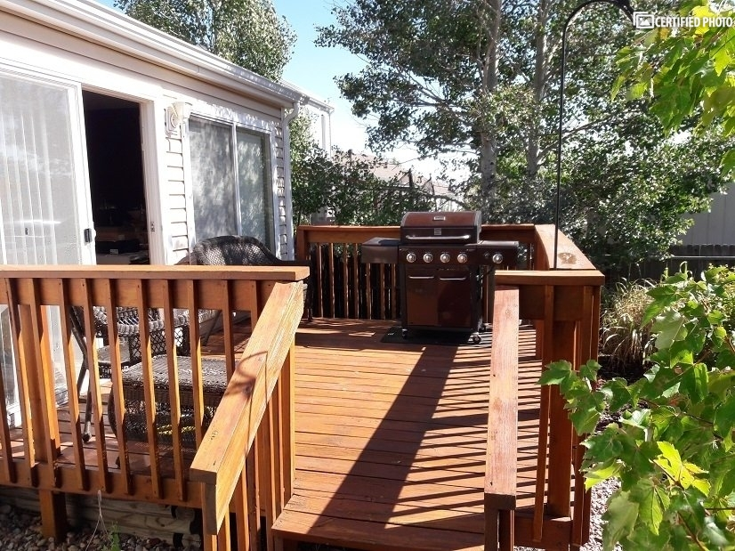 Raised deck & private, fenced backyard with garden
