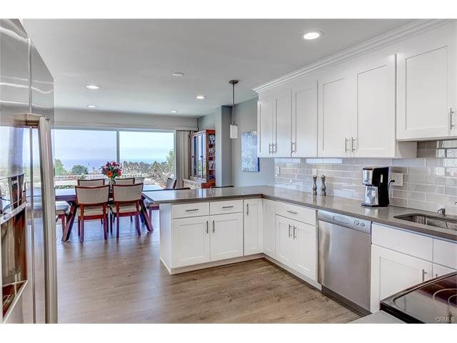 Kitchen has dishwasher, stove, oven & grill.