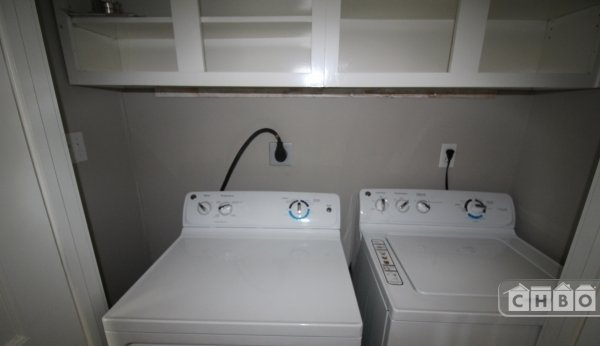 Brand new full size washer/dryer and storage above