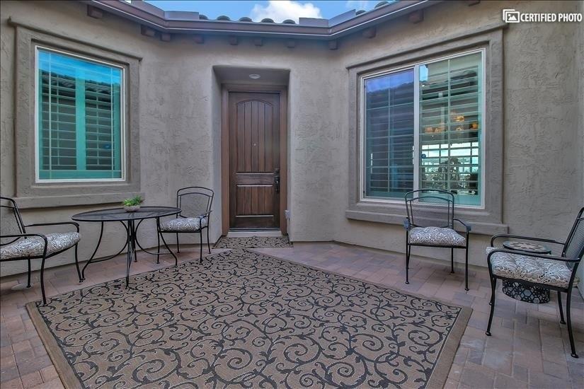 Courtyard leading to front door and guest suite door.