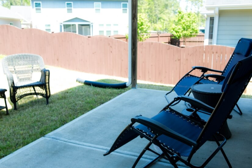 Retreat to the quiet back yard lounge space