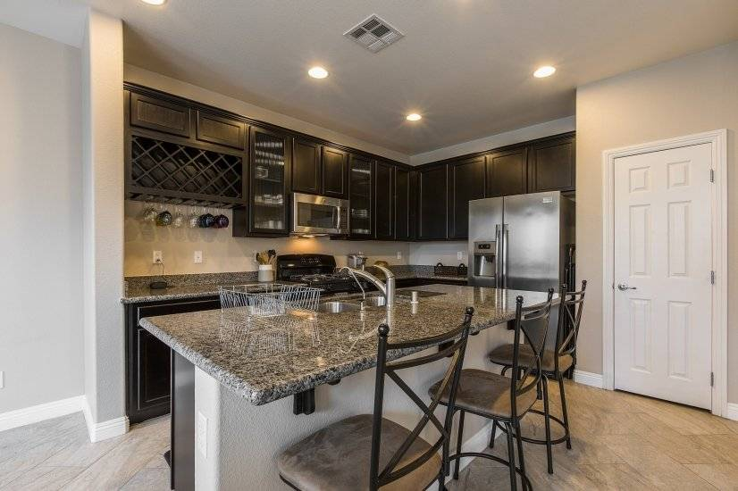 Kitchen with large center island and granite counter tops