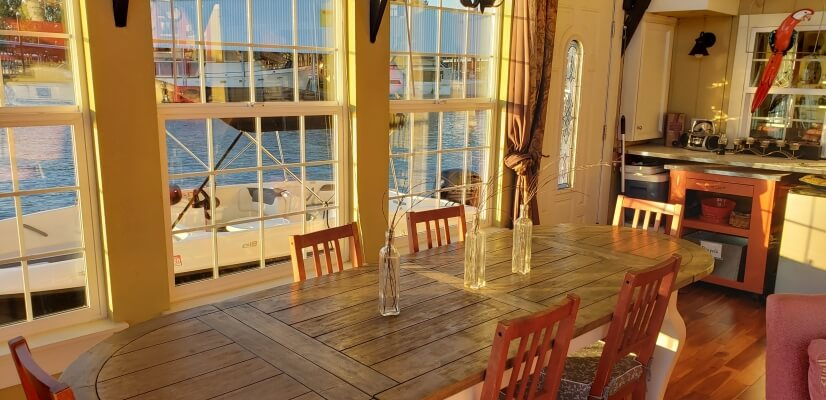 Sun-room dining with water view seats 6-8