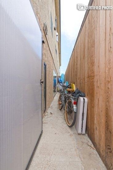 Locked storage area with shared bikes.