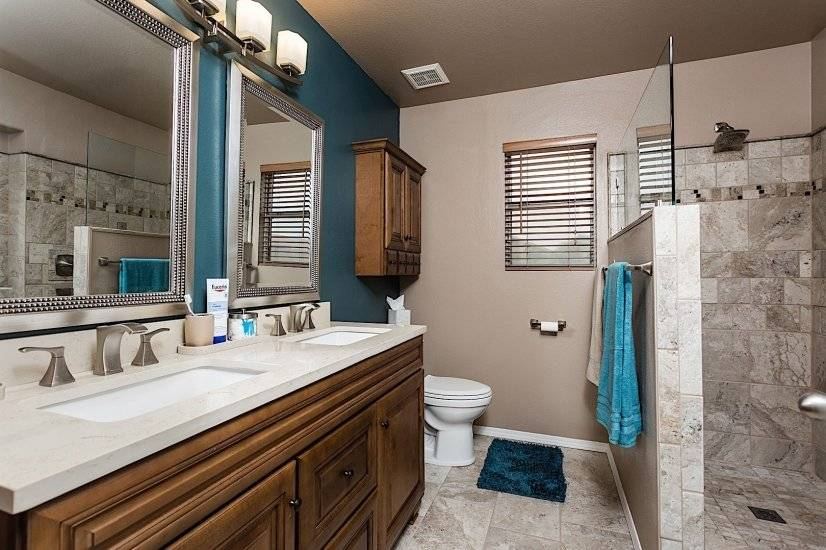 A walk-in shower and double vanity in the master bath
