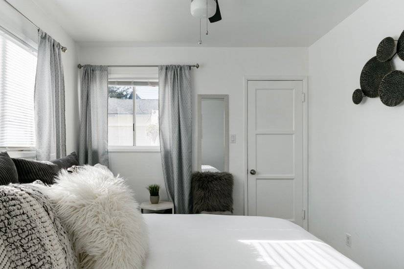 Bedroom with closet, lots of natural light