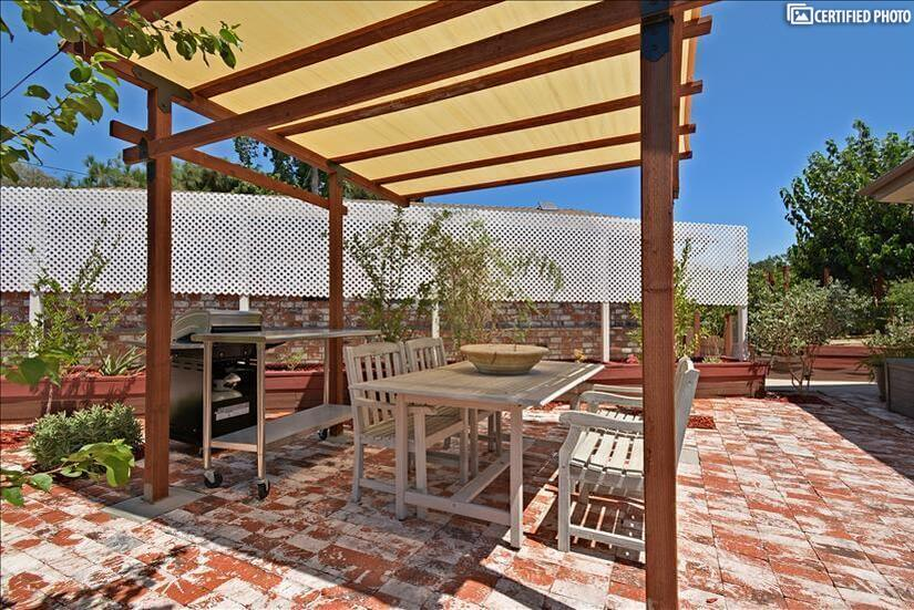 Outdoor dining space with gas and charcoal barbecues