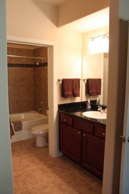 Master en suite with tile flooring and roman tub.