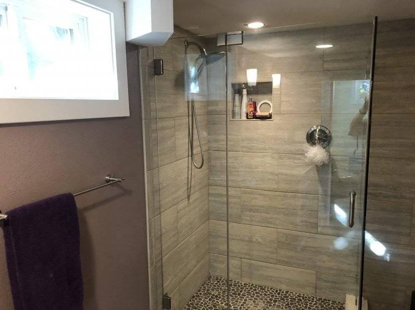 Big glass and porcelain tiled shower.