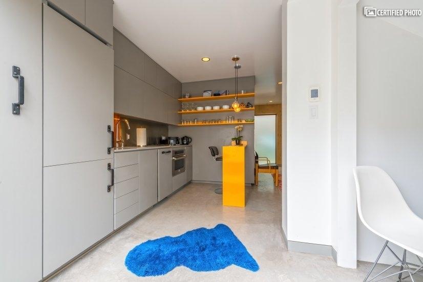 Built-in refrigerator + plenty of storage space in kitchen