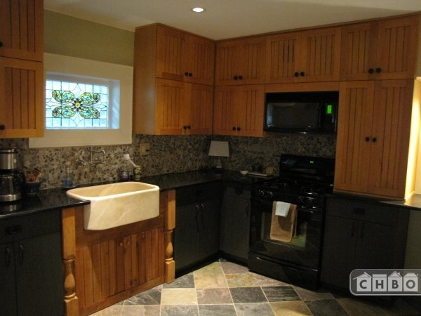 Granite counters and marble farmhouse sink in kitchen