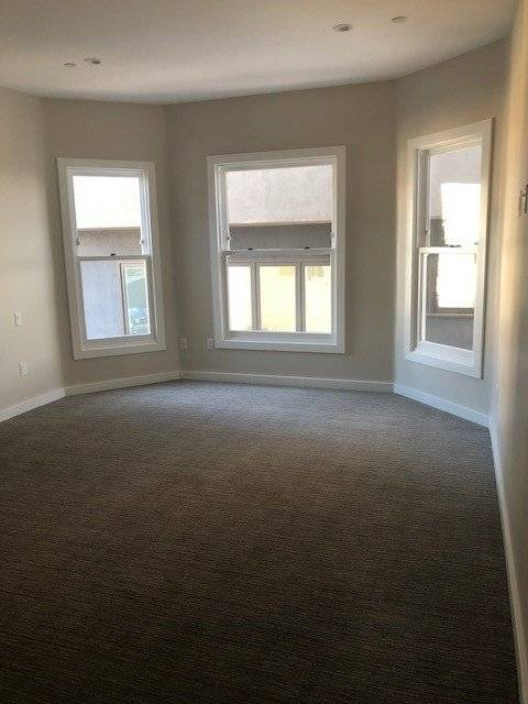 Large master suite with plenty of natural light & new carpet