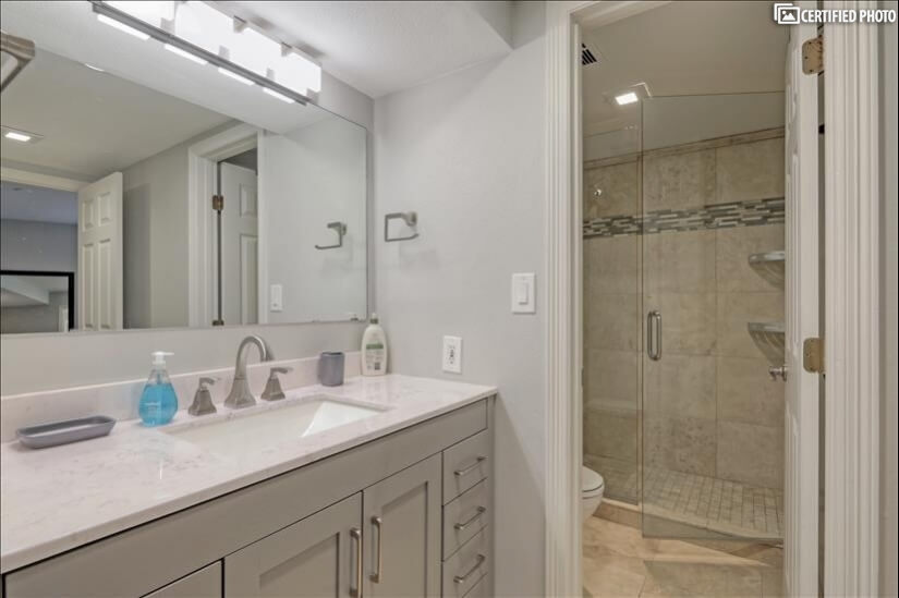 Updated Bathroom with large vanity and large walk-in shower