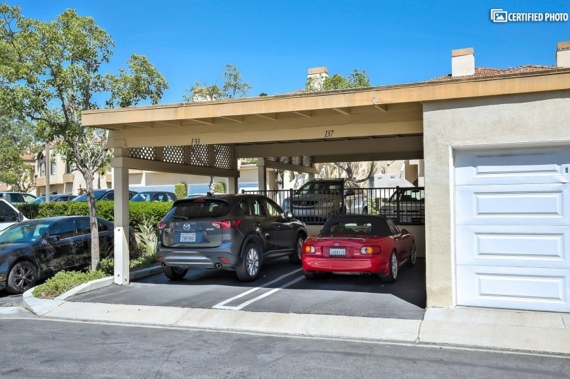 Dedicated carport in addition to one car garage