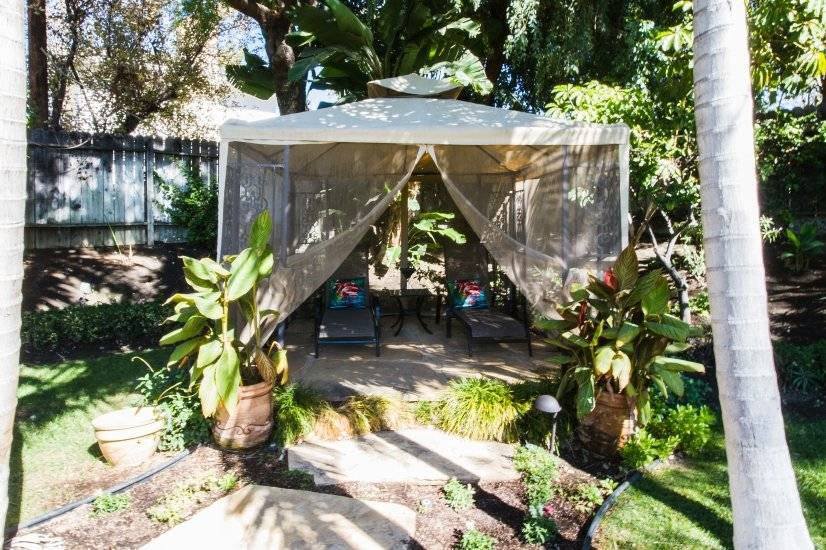 Gazebo offers 2 lounge chairs for relaxing in the garden