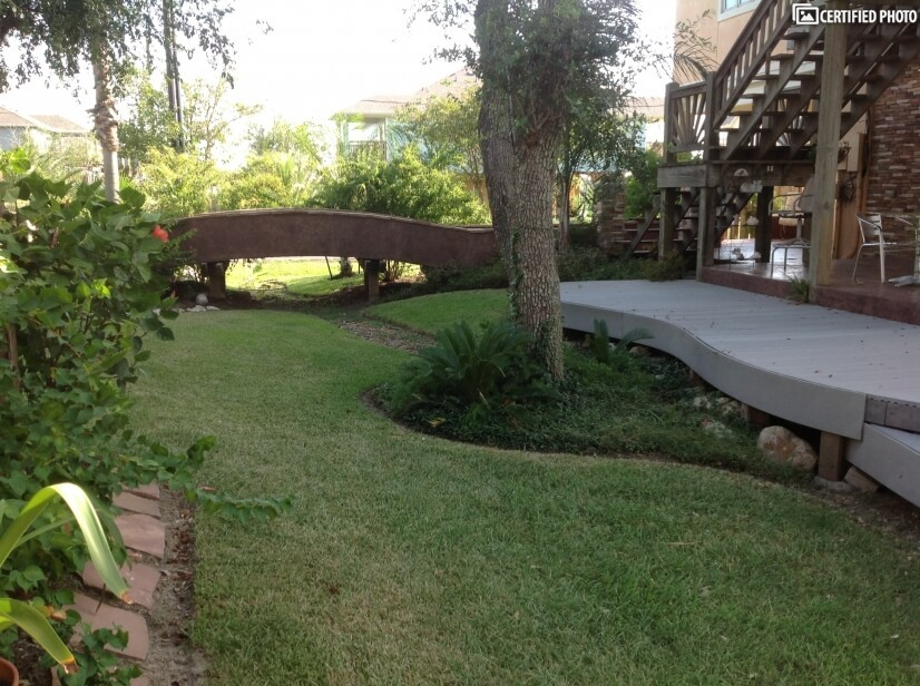 front yard with bridge and decking.