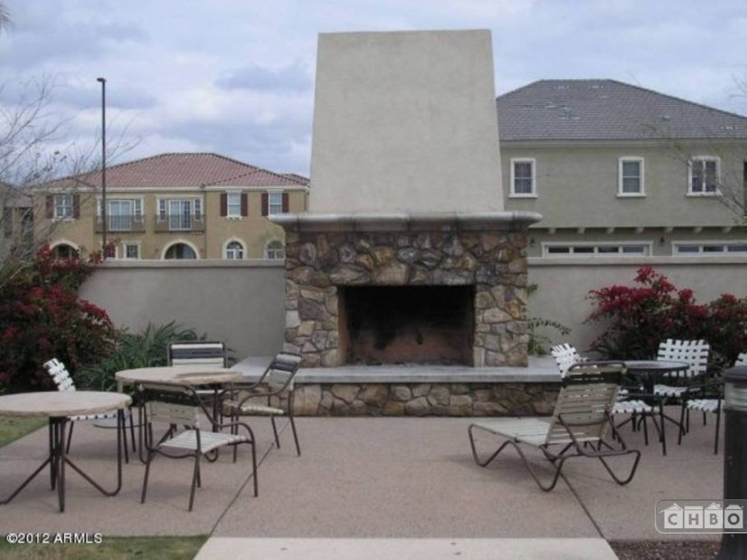Outdoor Fireplace at the Community pool - just steps from th