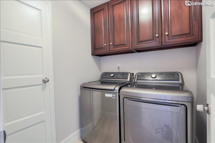 Downstairs Washer and Gas Dryer with closet and cabinets