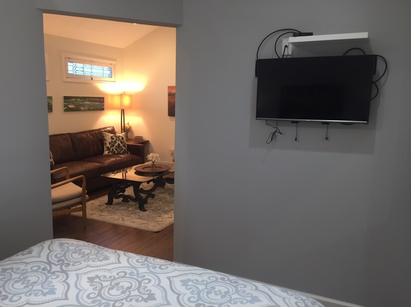 Flat screen TV in bedroom & living room