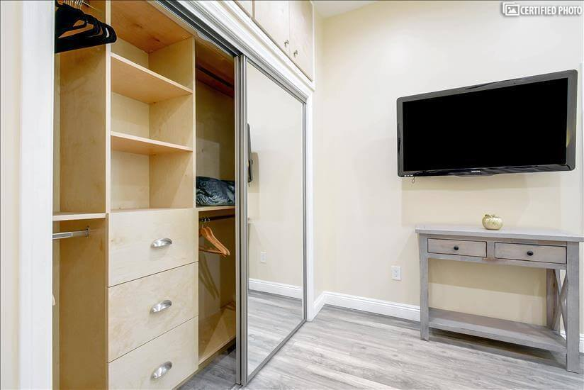 Spacious closet with drawers in master bedroom 2