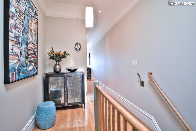 Warm radiant-heated hardwood floors throughout