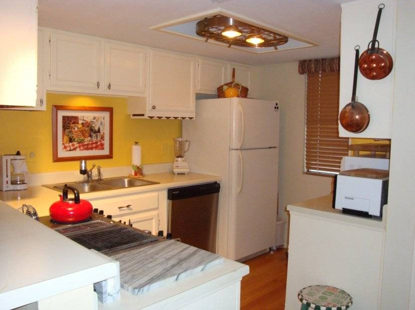 Fully equipped kitchen with hardwood floors.