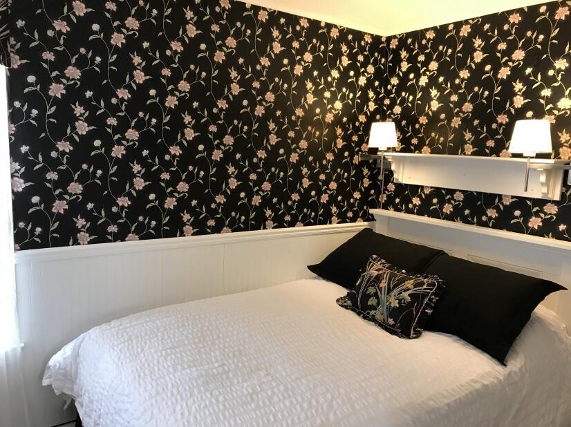 Bedroom with Headboard, book shelf, and lights