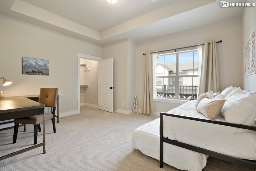 Large secondary bedroom functions as an office or bedroom