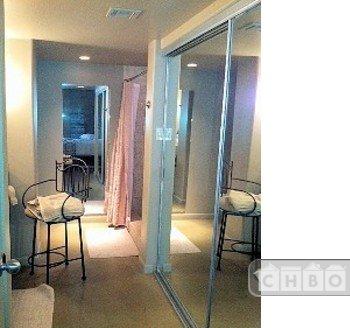 Master Bathroom is long, tiny tiled large shower - high tile