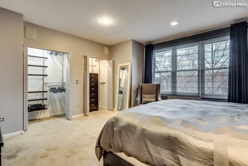 Master Bedroom with custom closets & window treatments