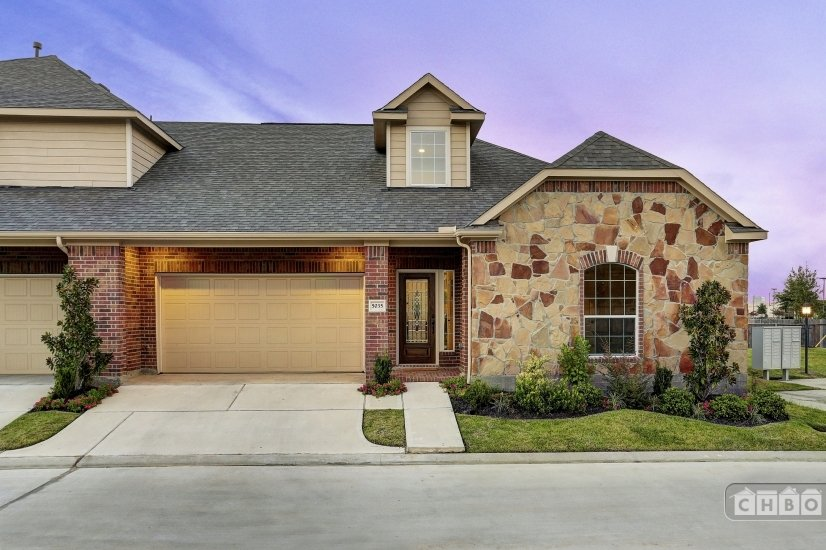 Stone front and garage parking in gated subdivision