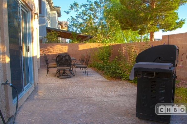 The 7-piece patio set and gas BBQ grill awaits you!