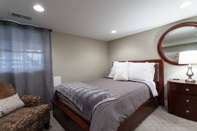Fourth bedroom with a queen bed