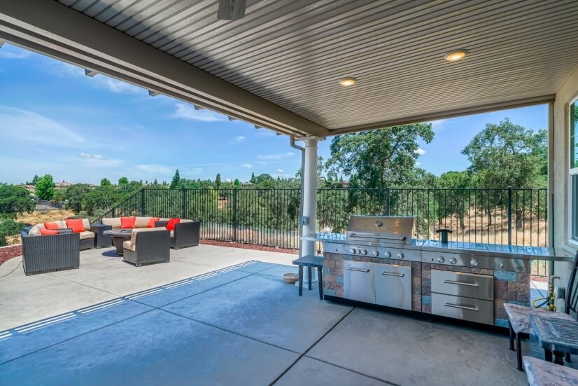 Backyard with outdoor kitchen and comfortable