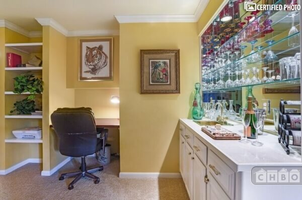 Wet bar on right and built in desk, fast inte
