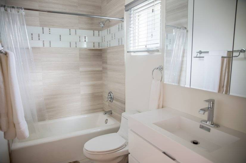 Large, soaker tub.  Well lit bathroom with ceiling heater.