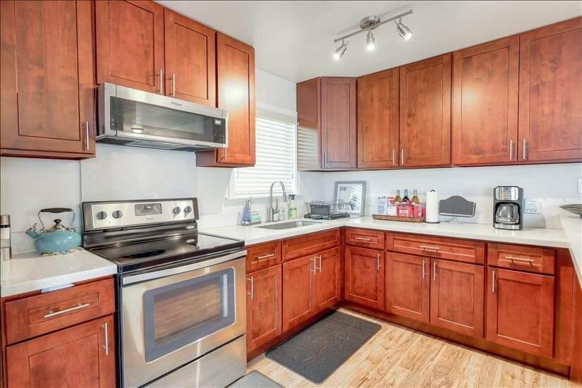 Kitchen includes appliances, dinnerware, cookware & utensils