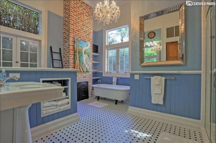 Massive master bath with clawfoot tub and sparkly chadelier