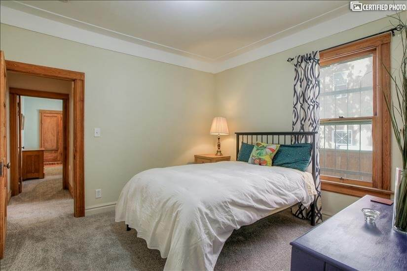Large window in bedroom that can be opened or closed