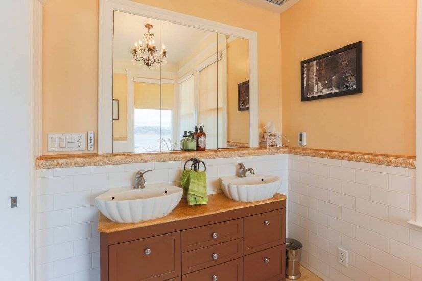 Your Master bath has custom double vanity & oversized mirror