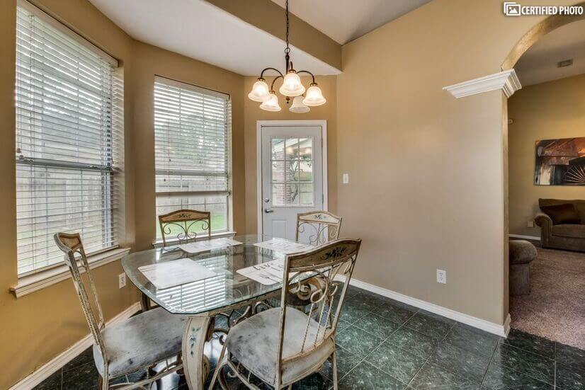 Breakfast nook opens to backyard with covered