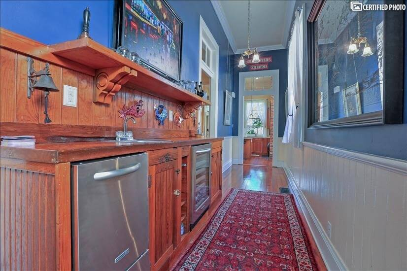 Custom cypress bar  near the kitchen and dining room