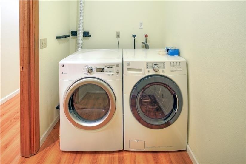 In-unit laundry room w/storage
