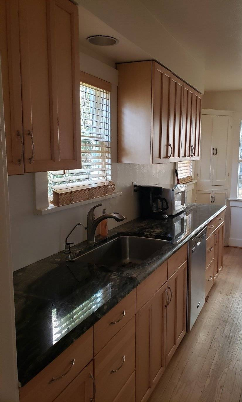 Kitchen with granite counters and stainless dishwasher