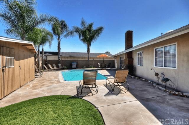 Private pool in backyard. Pool towels provide