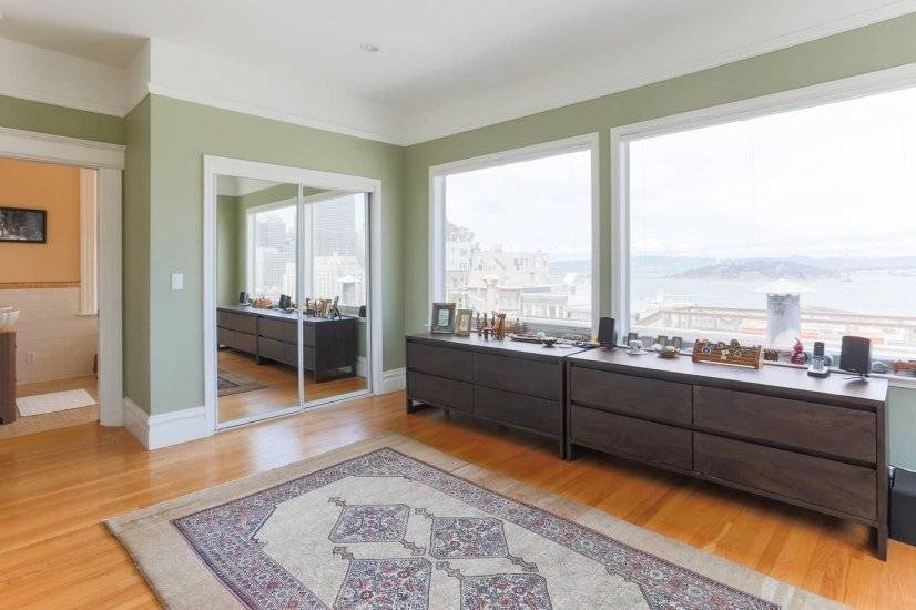 Huge master bedroom with 180-degree Bay and Downtown views