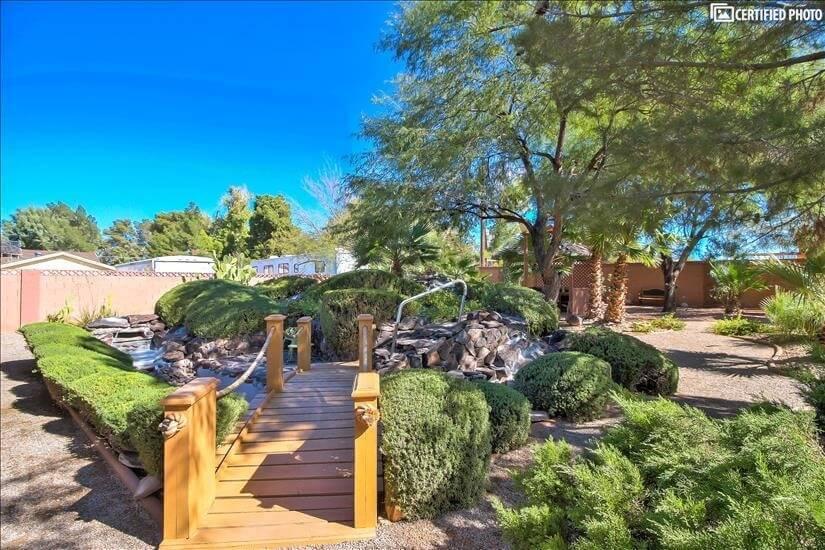 Bridge to grassy knoll in backyard