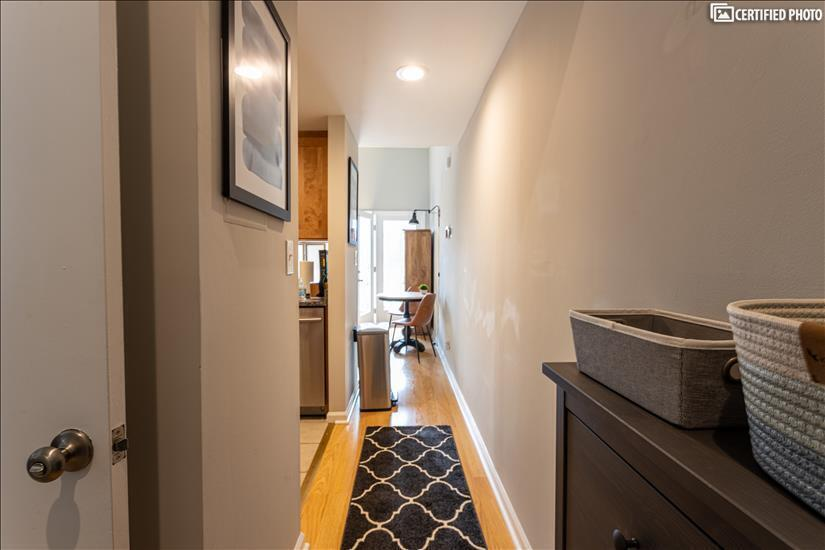 Entry has tile floor and baskets for keys, et