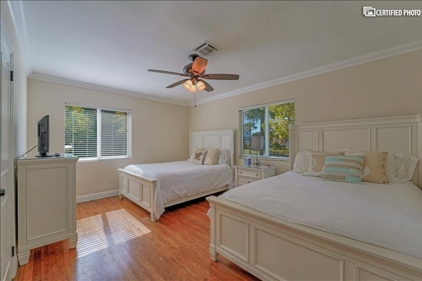2 Queen size beds with a TV with built-in DVD player.
